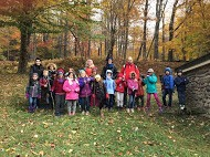 Elementary schoolers in a forest during an educational trip in the Catskills, NY