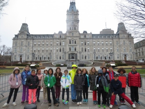 4th and 5th grader in front of the parliament building in Quebec, Canada
