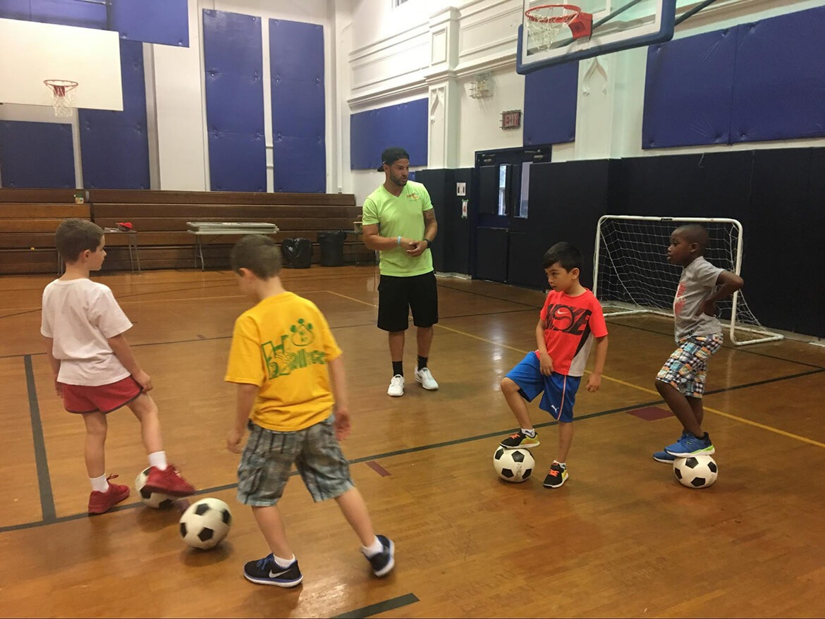 Kids from the French american academy playing soccer in an enrichment session