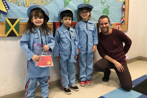 Prek3 students in a costume with their teacher