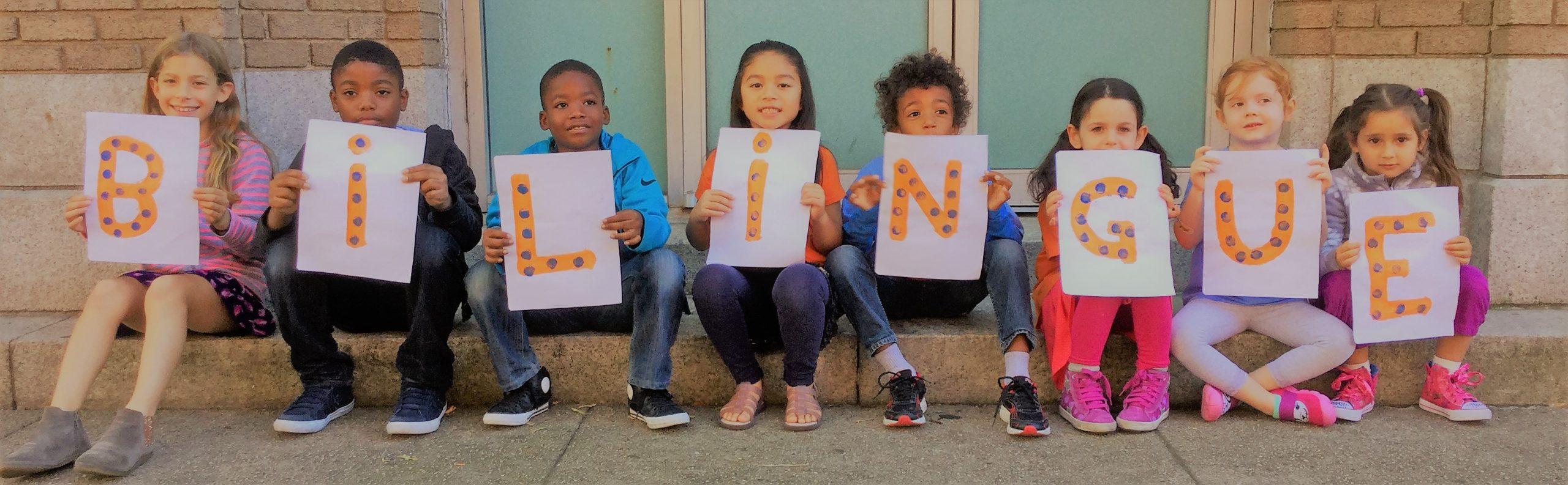 kids showing a bilingual panel