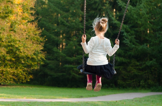 Little girl on a swing in a nice scenery in New Milford