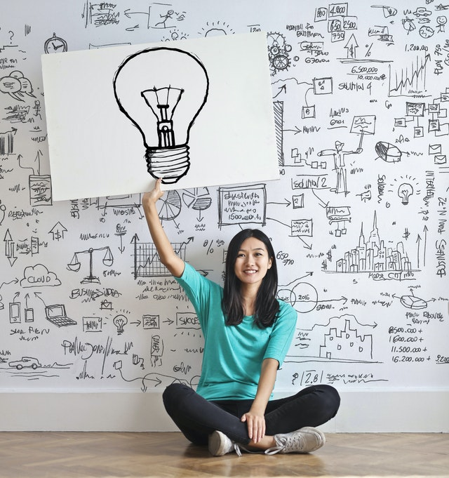 Woman getting an idea after receiving help tips and advices