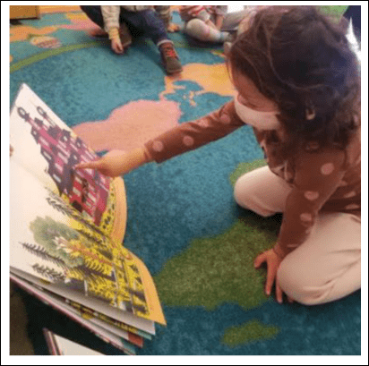 Prek3 students reflecting on a book from the Prix Albertine Jeunesse at the French american academy