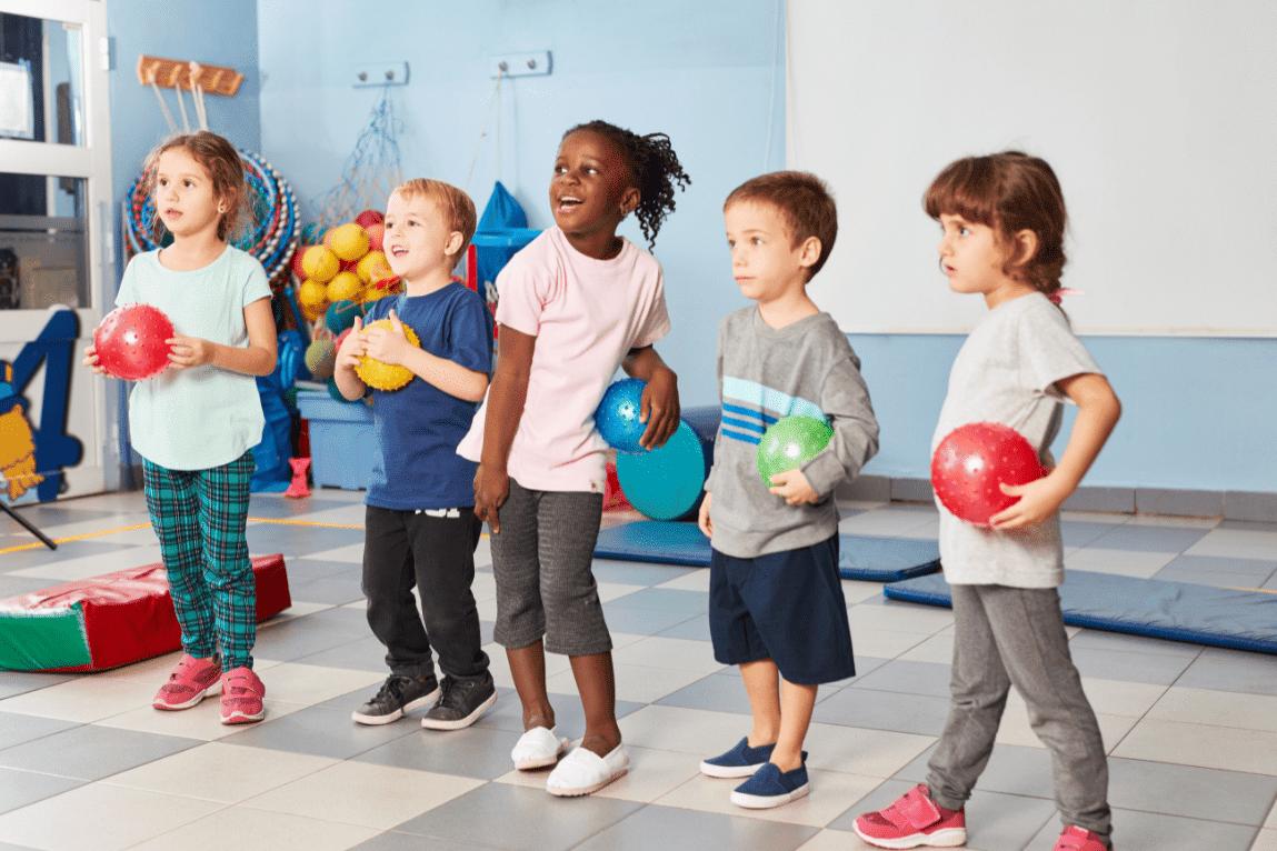 preschoolers in a gross motor room