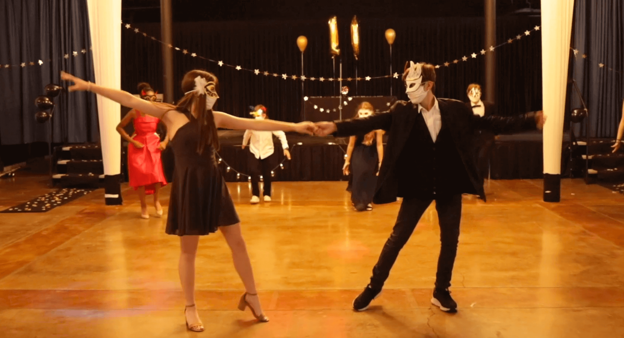 """Two students of the French American Academy dancing in the Musical """"Face a Face"""""""