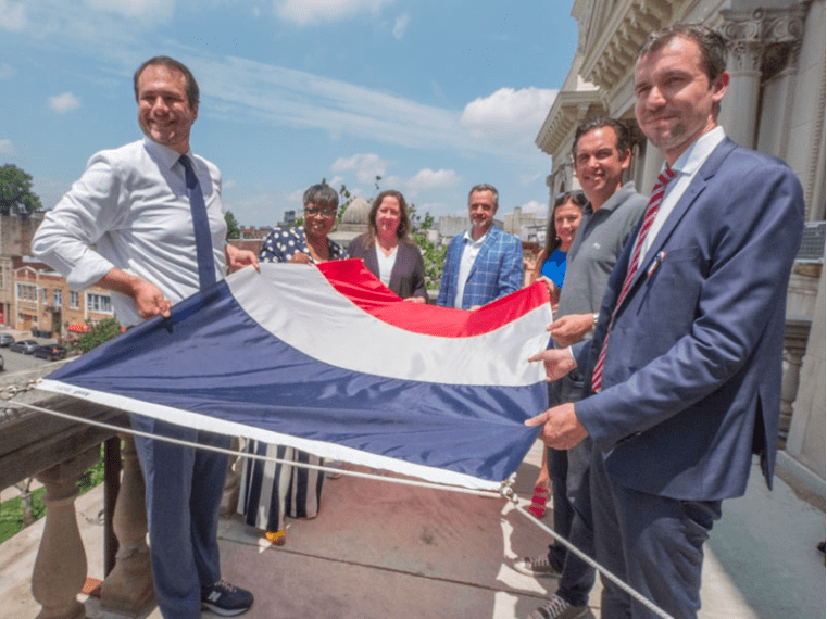 The French Consul Jeremie Robert, Jean Francois Gueguen and The Jersey City Mayor Steven Fullop raising the French Flag at the Jersey City City Hall
